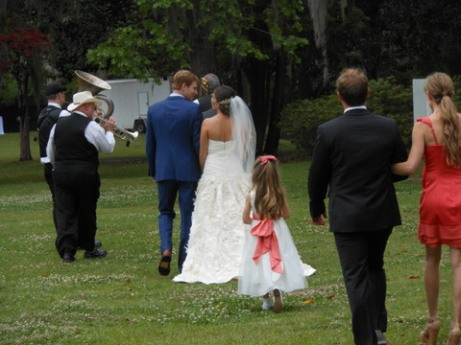 A jazz band serenaded the couple after the ceremony as they walked to the reception.