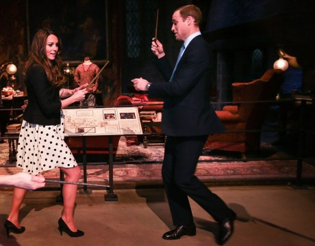 Britain's Catherine, Duchess of Cambridge and Prince William play with magic wands on a Harry Potter set at Warner Bros. Studios Leavesden