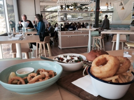 Our lunch - salt and pepper squid, tomato and goat's cheese salad, and a burger with enormous onion rings.