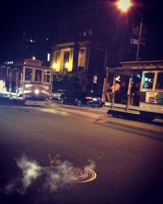 Trolley cars out the front of our hotel after dark.