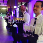 Waiters at the ready with trays of Mumm champagne.