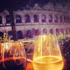 It's pouring with rain in Rome but the upside is you can get a front row seat at the Coloseum while you drink your wine!