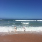 The eldest hitting the waves with a friend from preschool.
