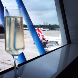 Sparkling wine in the Qantas lounge pre-departure.
