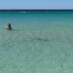 Me in the water at Eagle Bay. There's a full-length swimsuit shot on Instagram if your eyes can take it.