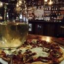 Pizza at the noisy bar.