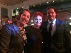 Workmates' selfie with Pauline, with bonus creepy spotlight on her face.