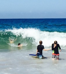 That's the youngest you can see in the middle of a wave with her arms in the air.