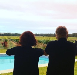 DD and I watching the kangaroos jump past the pool.