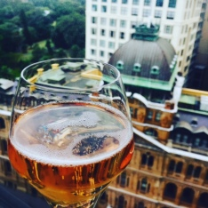 Sparkling rose with a hotel room view.