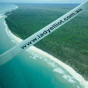 Flying out over Fraser Island to Lady Elliot.