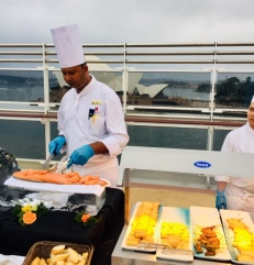 Carving the salmon with the Sydney Opera House as a backdrop.